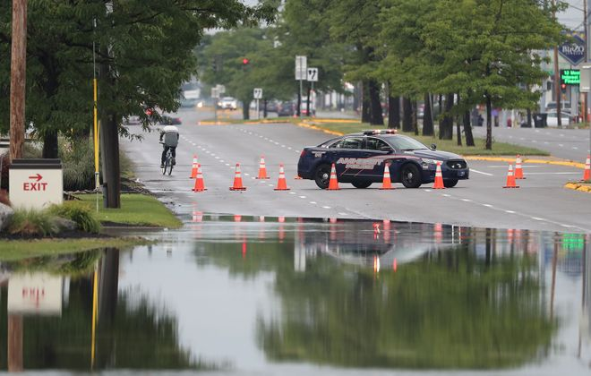A car stranded in the middle of the road  near Niagara Falls Boulevard in Amherst. (James P. McCoy/Buffalo News)