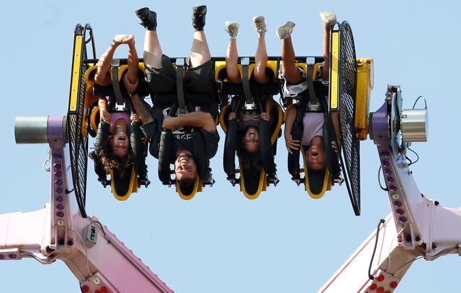 Visitors ride the Mind Warp at Fantasy Island. (Sharon Cantillon/Buffalo News)