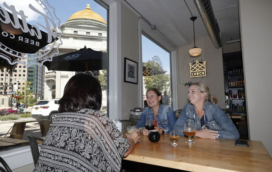 Coworkers Anita Scordato, left, Bridget Lohr and Leah Brockmyre enjoy beer from Fattey Beer Co. (Sharon Cantillon/News file photo)