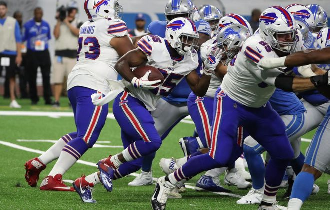 Buffalo Bills running back LeSean McCoy rushes up the middle in the first quarter at Ford Field in Detroit, Michigan on Friday, Aug. 23, 2019.  (James P. McCoy/Buffalo News)