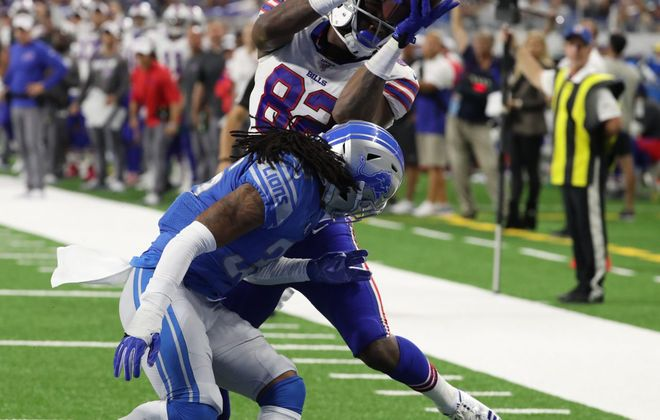 Bills wide receiver Duke Williams catches a touchdown pass over Lions defensive back Andre Chachere last week. (James P. McCoy/Buffalo News)