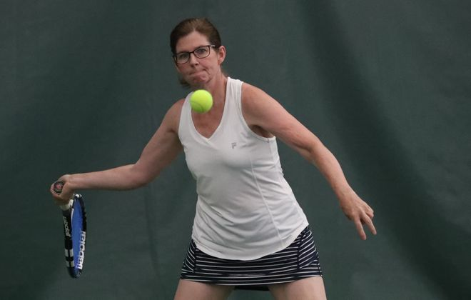 Jane Early, 49, is 5-6, 135 pounds and is among the hardest hitting tennis players in the area. (James P. McCoy/Buffalo News)