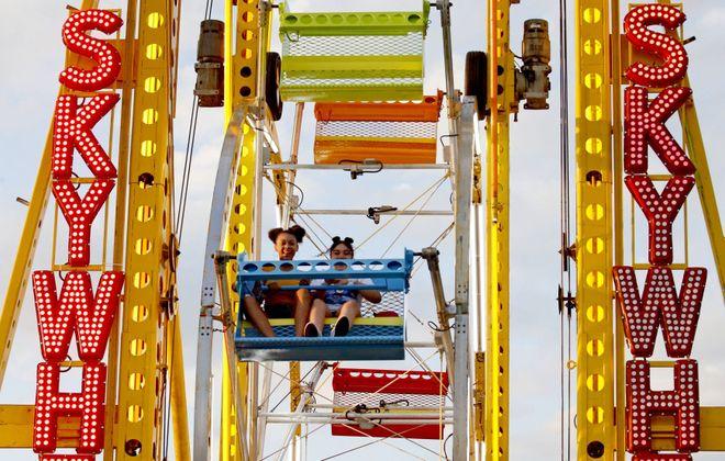 Courtney Harris, 13, left, and Hannah Snead, 11, enjoy a ride on the Skywheel at the 2019 Erie County Fair. (Robert Kirkham/Buffalo News)