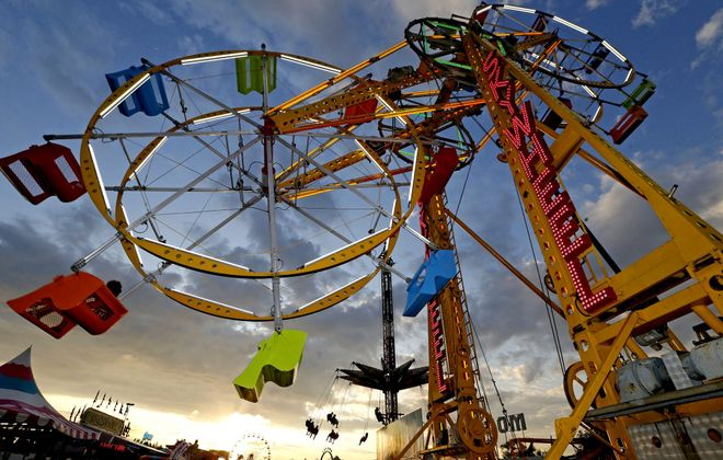 The Sky Wheel, or double Ferris wheel, is back at the Erie County Fair for the first time in more than 20 years. (Robert Kirkham/Buffalo News)