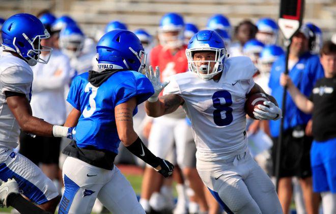 University at Buffalo running back Dylan McDuffie runs during practice at UB Stadium in August. (Harry Scull Jr./Buffalo News)