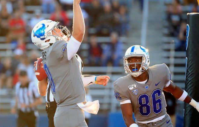 University at Buffalo quarterback Matt Myers points to the sky after scoring a rushing touchdown against Robert Morris. (Harry Scull Jr./News file photo)