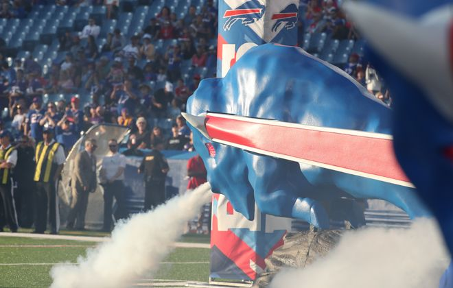 """Bills show off the new buffaloes in the """"Leading the Charge"""" entrance.  (James P. McCoy/Buffalo News)"""