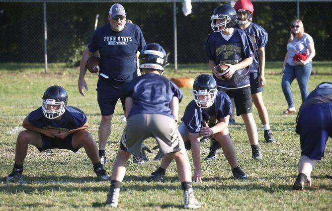 Frewsburg coach Terrance Gray shouts out plays with his new eight-man team. (Robert Kirkham/Buffalo News)
