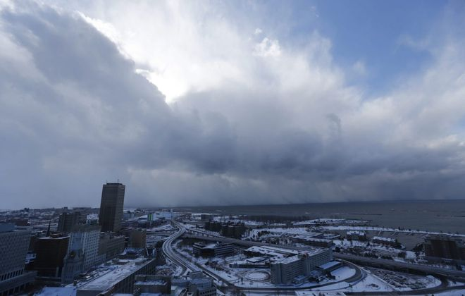 """The """"Wall of Snow"""" lake-effect snow band moved through the Southtowns as seen from the observation deck at City Hall on Nov. 18, 2014. (Derek Gee/Buffalo News)"""