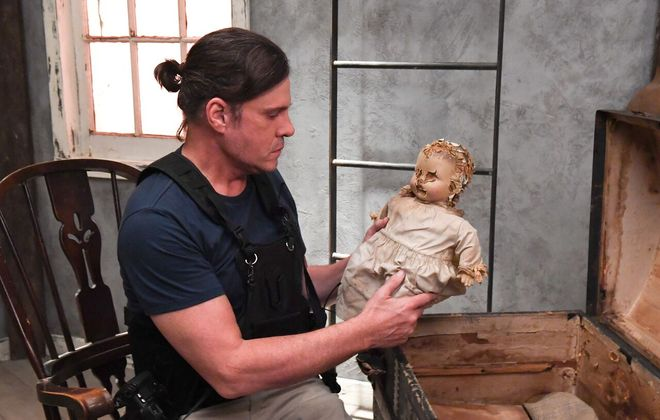 """Actor Craig Sheffer and a creepy doll in a scene filmed in the Dunkirk Lighthouse for """"Widow's Point."""""""