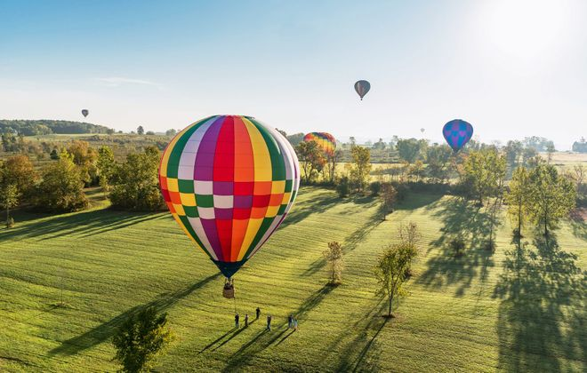 From Sept. 19-22, vibrantly colored hot air balloons dot the scenic skyline of the Adirondacks for this annual free festival. (Gus Carayiannis)