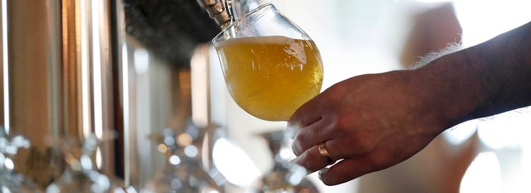A beer is poured at Resurgence Brewing Co. at 55 Chicago St. (Sharon Cantillon/Buffalo News)