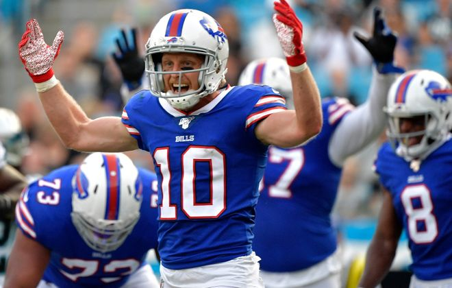 Cole Beasley of the Bills signals for a touchdown by teammate LeSean McCoy (Grant Halverson/Getty Images)