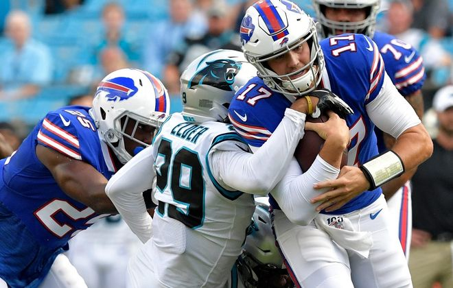 Josh allen tries to avade Panthers' Corn Elder. (Grant Halverson/Getty Images)