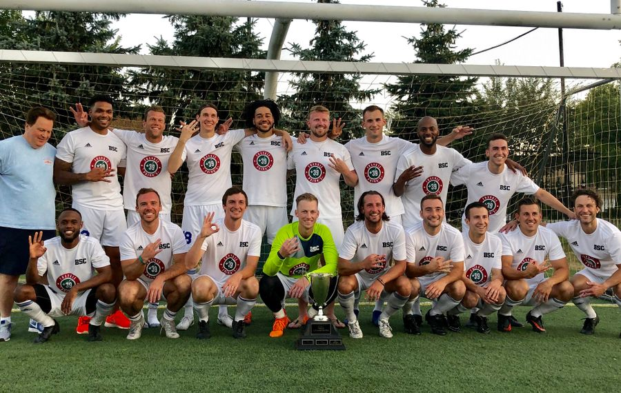 BSC Raiders pose for a photo after winning their third straight BDSL premier title. (Ben Tsujimoto/Buffalo News)