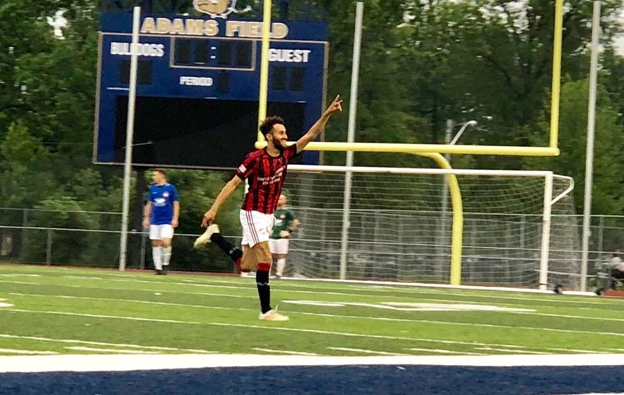 Ali Mohamed celebrates a goal against Sharpshooters during Tehel Cup action. (Ben Tsujimoto/News file photo)