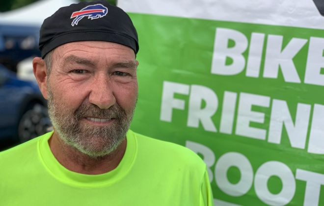 Mark Mitri, a leader with the Slow Spokes bike club, helps assure safe bicycling during at least three group rides a week this time of year. (Scott Scanlon/Buffalo News)