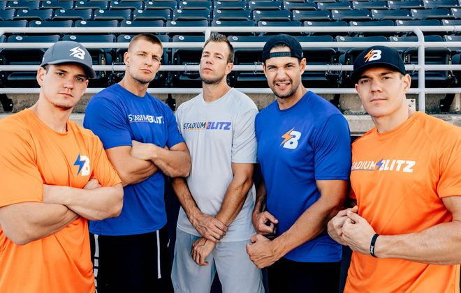 Dan Gronkowski, second from right, explained the concept of the Stadium Blitz obstacle course race. All five brothers have partnered with Complex SE for the new touring event. (Photo by Heather Krug)