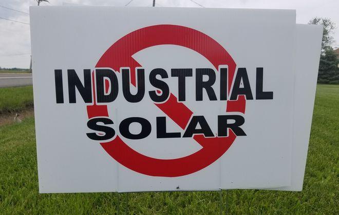 A yard sign opposing the Bear Ridge Solar project on a lawn in Cambria June 19, 2019. (Thomas J. Prohaska/Buffalo News)