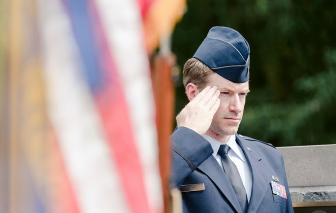 Amherst Town Board Member Shawn Lavin, a first lieutenant in the Air National Guard's 107th Attack Wing, renders a salute at an August ceremony at the Amherst Veterans Memorial Wall. Lavin's unit was activated for service in New York City as part of the Covid-19 response. (Staff Sgt. Ryan Campbell/Department of Defense)