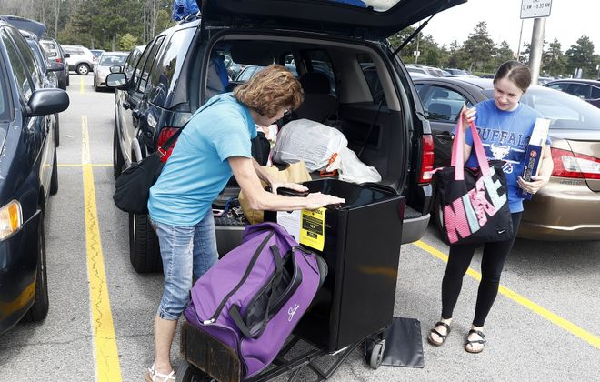 Amanda Richardson, of Binghamton, moves on to the University at Buffalo North Campus for the 2017-18 school year with help from her mom, Karen Dickson. (John Hickey/News file photo)