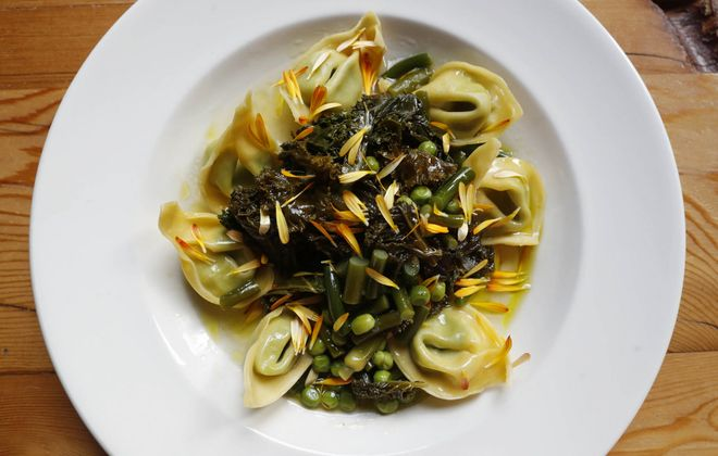 The Black Sheep's tortellini dish is made with greens, garlic scapes, peas, Parmesan broth and pistou. (Sharon Cantillon/Buffalo News)