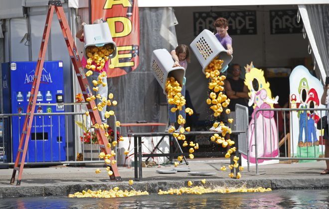 Rubber ducks plummet down into the Canals at Canalside during the Rotary Duck Derby in 2017. The event is back again this Sunday. (Robert Kirkham/News file photo)