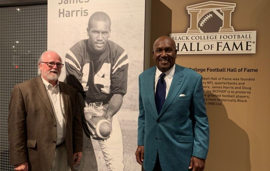 Joe Horrigan and James Harris at a display for the Black College Football Hall of Fame at the Pro Football Hall of Fame. (Courtesy of Pro Football Hall of Fame)