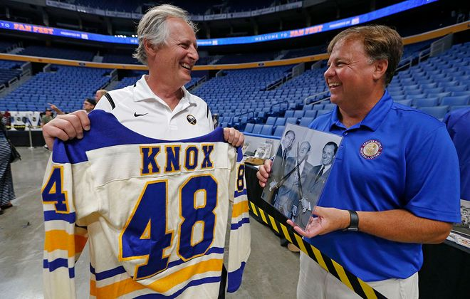 Seymour Knox IV holds up a jersey that was presented to his father on the ice for his 48th birthday in the mid-'70s on Saturday, Aug. 17, 2019.  (Robert Kirkham/Buffalo News)