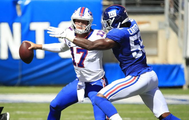 Josh Allen tries to escape the grasp of the Giants' Lorenzo Carter during the second quarter at MetLife Stadium. (Harry Scull Jr./Buffalo News)