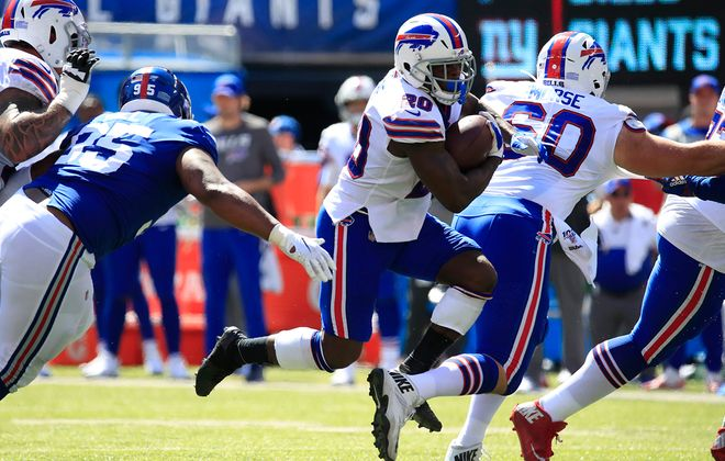 Buffalo Bills running back Frank Gore runs against the New York Giants during the first quarter at MetLife Stadium on Sunday, Sept. 15, 2019. (Harry Scull Jr./Buffalo News)