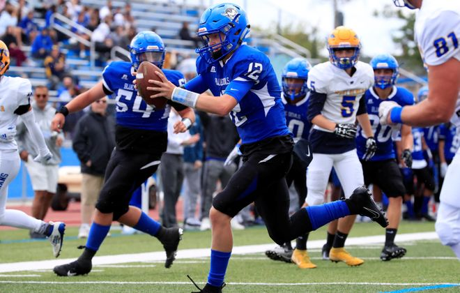 Kenmore West quarterback Zach Boyes scores one of his five touchdowns Saturday during the Blue Devils' win over West Seneca West at Crosby Field. (Harry Scull Jr./Buffalo News)