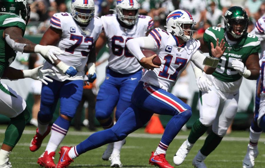 Bills quarterback Josh Allen rushes for a first down past New York Jets strong safety Jamal Adams. (James P. McCoy/News file photo)