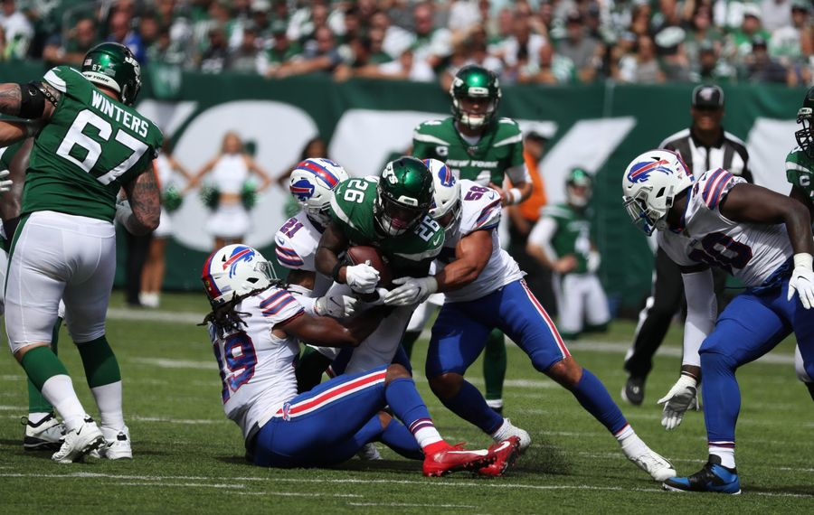Bills middle linebacker Tremaine Edmunds (49), free safety Jordan Poyer (21) and outside linebacker Matt Milano (58) tackle New York Jets running back Le'Veon Bell (26) for a loss in the second quarter Sunday at MetLife Stadium in East Rutherford, N.J. (James P. McCoy/Buffalo News)