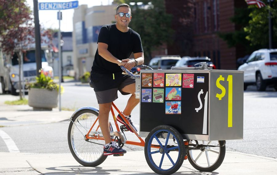 James Karagiannis pedals his cart on East Lovejoy Street as part of his effort to sell ice cream on every street in the city. (Mark Mulville/Buffalo News)