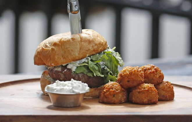 The No. 12 burger wrapped with with Parma prosciutto, topped with Urbani white truffle cream cheese, arugula and a side of tater tots at Allen Burger Venture. (Robert Kirkham/Buffalo News)