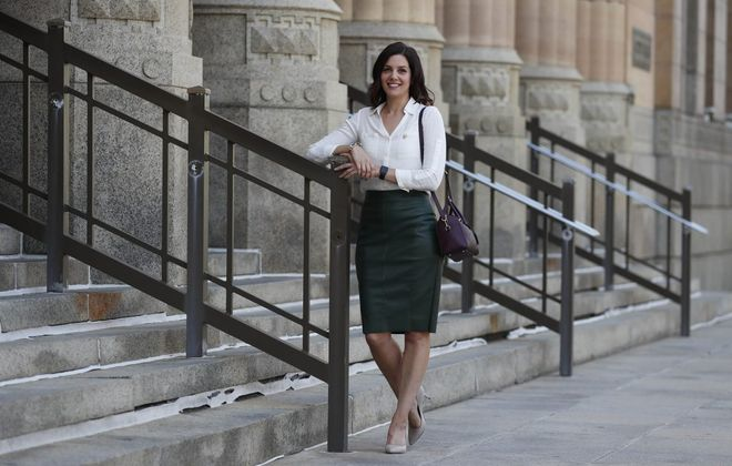 Jessica Brown, director of administration and finance for the City of Buffalo, wears a favorite outfit in front of City Hall. (Sharon Cantillon/Buffalo News)