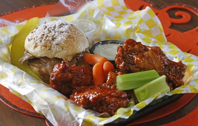 Fill up on a half-and-half at Wingnutz with a beef on weck sandwich and five wings for $10.50. (Robert Kirkham/Buffalo News)