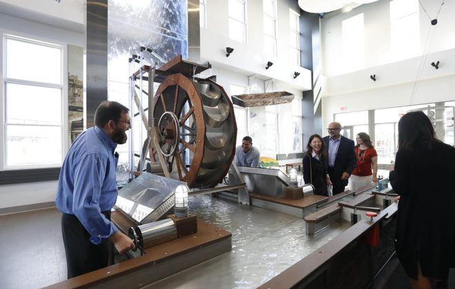 Site location consultants from out of town are given a tour of Buffalo by Invest Buffalo Niagara. One of their stops is Explore & More Ralph C. Wilson Jr. Children's Museum, where they checked out the waterfall.  (Sharon Cantillon/Buffalo News)