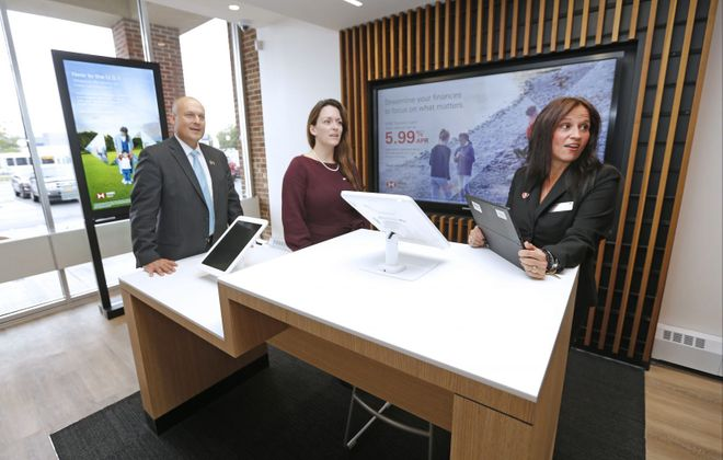 Lawrence Orsini, left, Katie Jenkins and Michele Kertzie are seen inside the new HSBC branch in Depew. (Robert Kirkham/Buffalo News)
