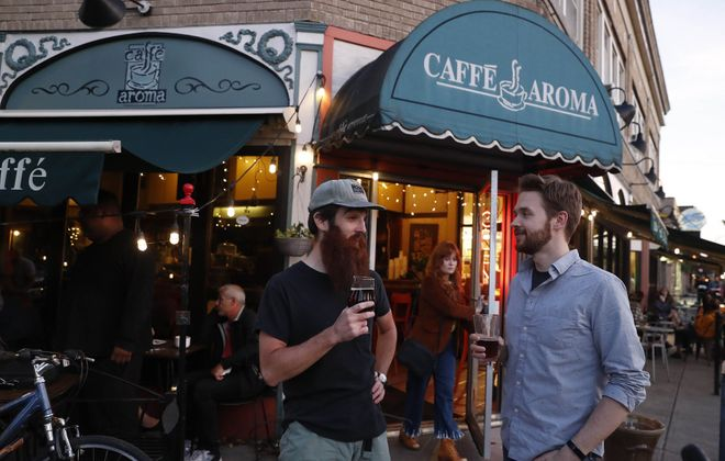 Josh Dolph, left, and Eddie McNamee hang out in front of Caffe Aroma. (Sharon Cantillon/Buffalo News)