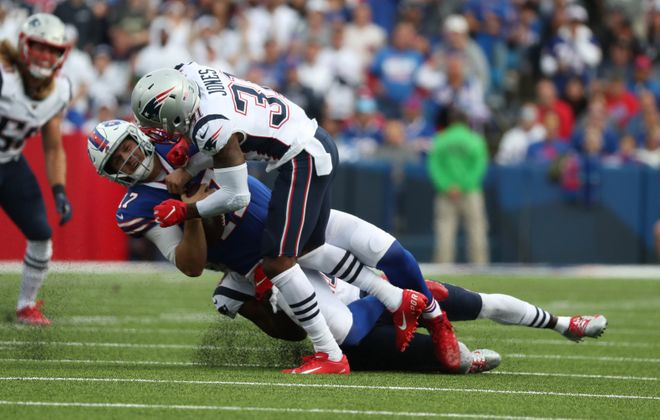 Patriots cornerback Jonathan Jones knocks Bills quarterback Josh Allen out of the game with a hit to the head. (James P. McCoy/Buffalo News)