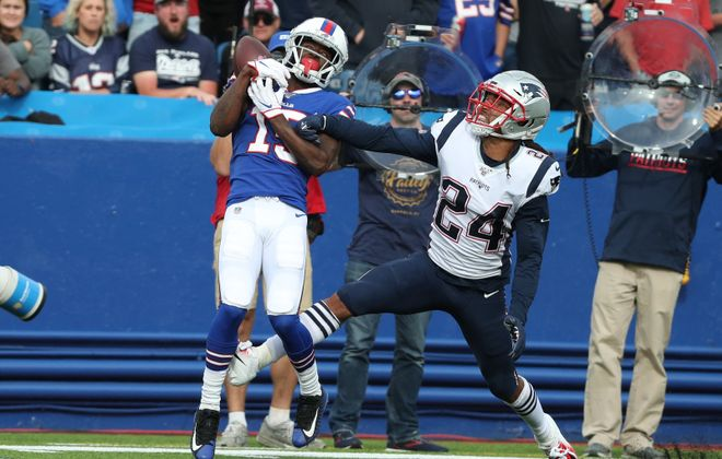 Buffalo Bills wide receiver John Brown (15) catches a pass for a first down against New England Patriots cornerback Stephon Gilmore (24) in the fourth quarter at New Era Field on Sunday, Sept. 29, 2019. (James P. McCoy/Buffalo News)