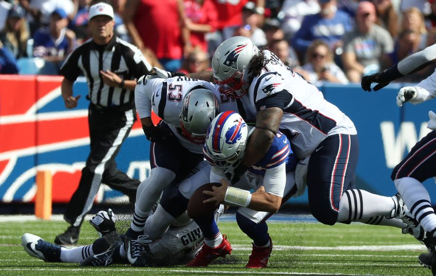 Bills quarterback Josh Allen fumbles while running in the first quarter against the Patriots  (James P. McCoy/Buffalo News)