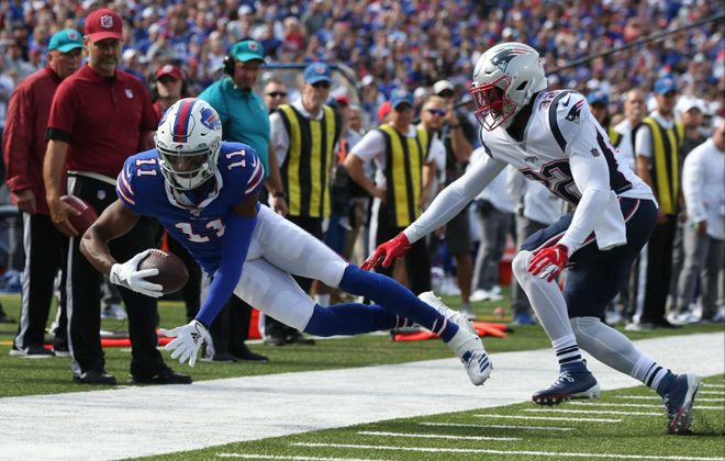 Bills wide receiver Zay Jones catches a pass for a first down over Patriots free safety Devin McCourty in the third quarter. (James P. McCoy/Buffalo News)