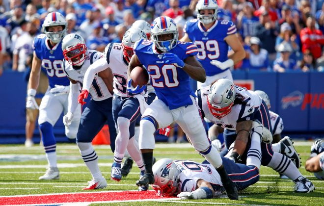 Bills running back Frank Gore rushes against the New England Patriots. (Harry Scull Jr./Buffalo News)