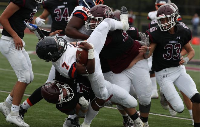 Orchard Park's Michael Pataky slams Bennett's Devotie Pompey to the ground during Saturday's Class AA division clash at Quaker Field in Orchard Park. (James P. McCoy/Buffalo News)