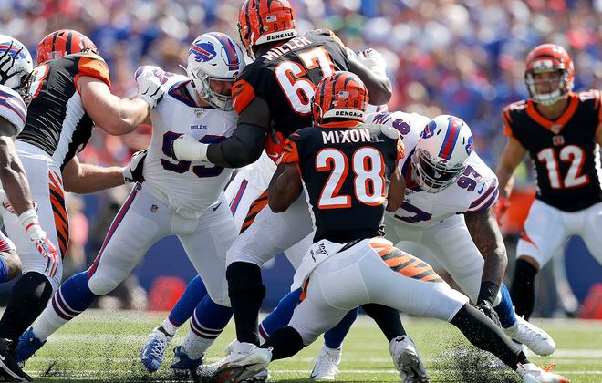 Bills defensive tackles Harrison Phillips (99) and  Jordan Phillips (97) surround Cincinnati Bengals running back Joe Mixon. ((Mark Mulville/Buffalo News)
