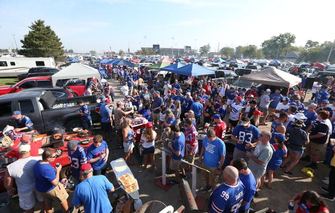 Bills fans party in the parking lot during pregame at New Era Field before the game against the Bengals. (James P. McCoy/Buffalo News)