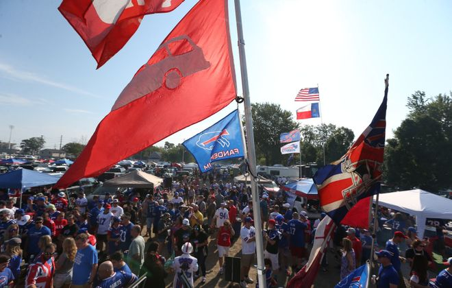 Bills fans party in the parking lot during pregame at New Era Field (James P. McCoy/Buffalo News)